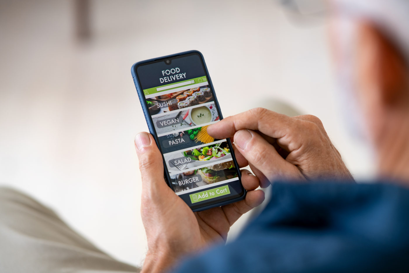 Man using ordering app to order delivery food